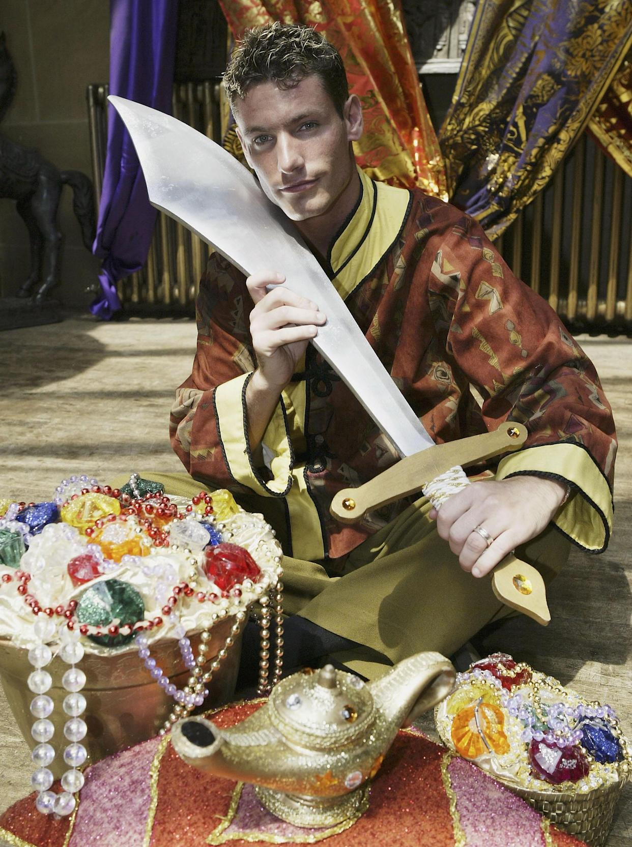 CROYDON, ENGLAND - JULY 9:  Actor Dean Gaffney poses with props to promote the pantomime