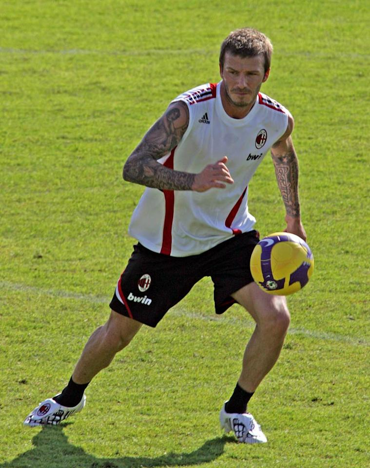 "Meanwhile, it was back to business for David Beckham. The soccer star joined his AC Milan teammates for training in Dubai on Thursday. Gorilla Pictures/<a href=""http://www.splashnewsonline.com"" target=""new"">Splash News</a> - January 2, 2009"