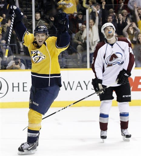 Nashville Predators right wing Matt Halischuk (24) celebrates a goal by teammate Sergei Kostitsyn as Colorado Avalanche defenseman Stefan Elliott, right, looks up at the scoreboard in the second period of an NHL hockey game on Thursday, March 8, 2012, in Nashville, Tenn. (AP Photo/Mark Humphrey)