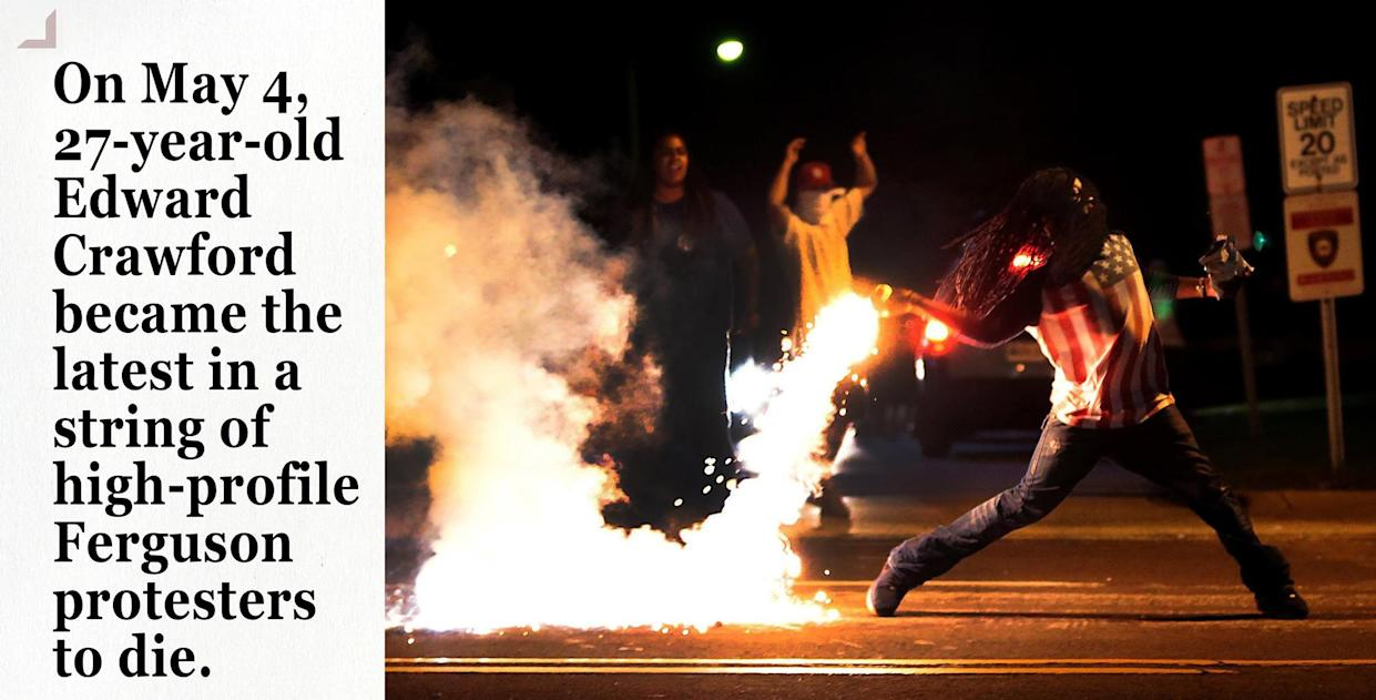 Edward Crawford returns a tear gas container shot by tactical police officers in Ferguson. (Photo: Robert Cohen/St. Louis Post-Dispatch via ZUMA Press)