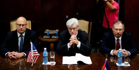 Mississippi Governor Phil Bryant talks to Cuba's Minister of Foreign Trade and Investment Rodrigo Malmierca in Havana, Cuba