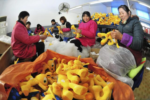 Employees make dolls of Fuleco the Armadillo, the official mascot of the FIFA 2014 World Cup in Brazil, at a factory in Tianchang, Anhui province December 10, 2013. The 2014 World Cup finals will be held in Brazil from June 12 through July 13. REUTERS/China Daily (CHINA - Tags: SPORT SOCCER BUSINESS EMPLOYMENT) CHINA OUT. NO COMMERCIAL OR EDITORIAL SALES IN CHINA