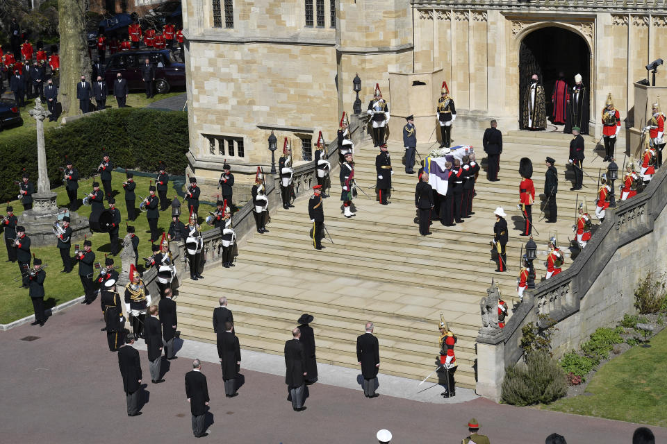 The coffin arrives at St George's Chapel for the funeral of Britain's Prince Philip inside Windsor Castle in Windsor, England, Saturday, April 17, 2021. Prince Philip died April 9 at the age of 99 after 73 years of marriage to Britain's Queen Elizabeth II. (Justin Tallis/Pool via AP)