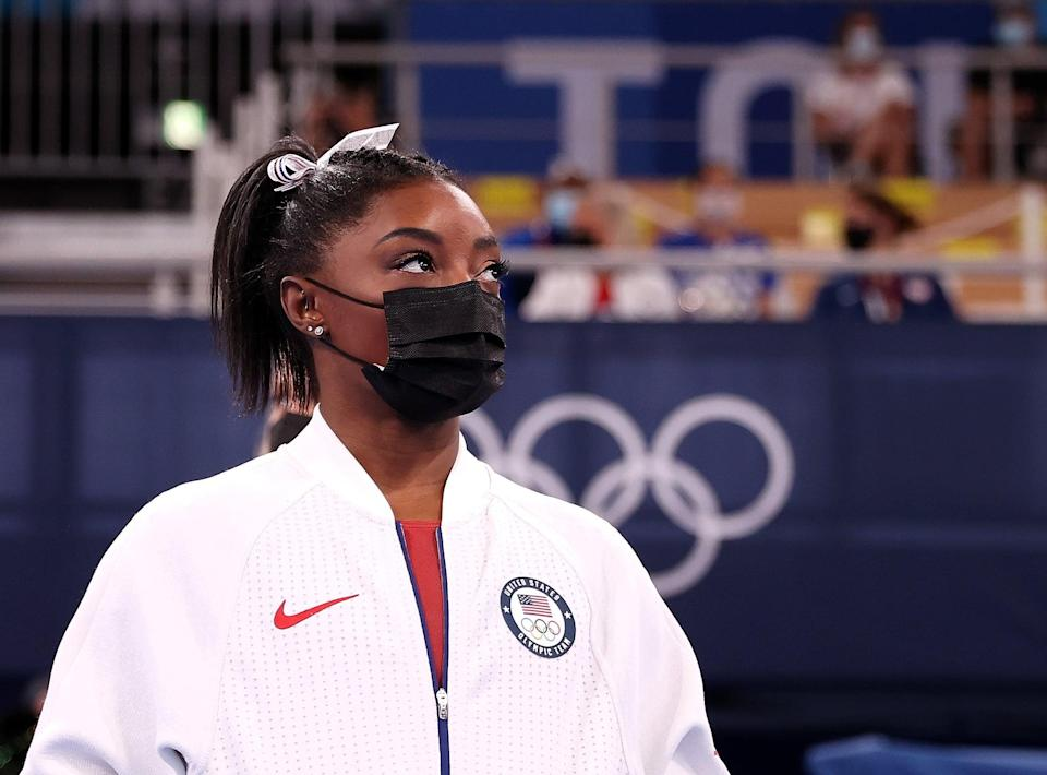 Simone Biles of the United States looks on during the artistic gymnastics women's team final at the Tokyo 2020 Olympic Games in Tokyo, Japan, July 27, 2021. (Photo by Cao Can/Xinhua via Getty Images)