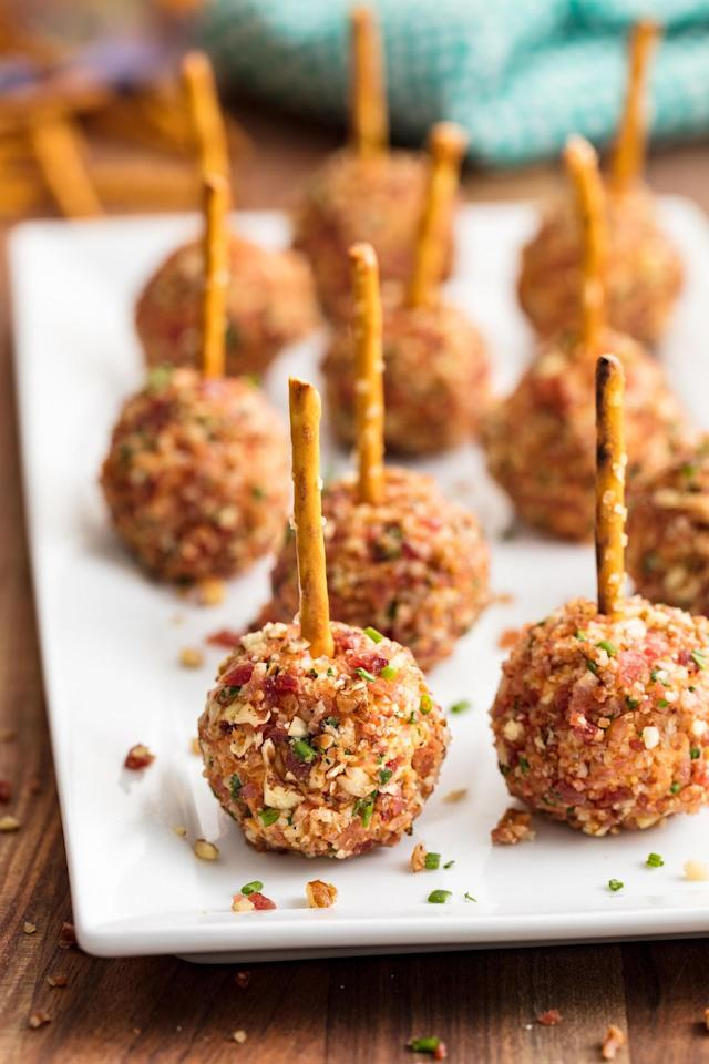 """<p>Our favorite word to hear in front of cheese is """"loaded.""""</p><p>Get the recipe from <a href=""""https://www.delish.com/cooking/recipe-ideas/recipes/a50204/cheese-ball-bites-recipe/"""" target=""""_blank"""">Delish</a>.</p>"""