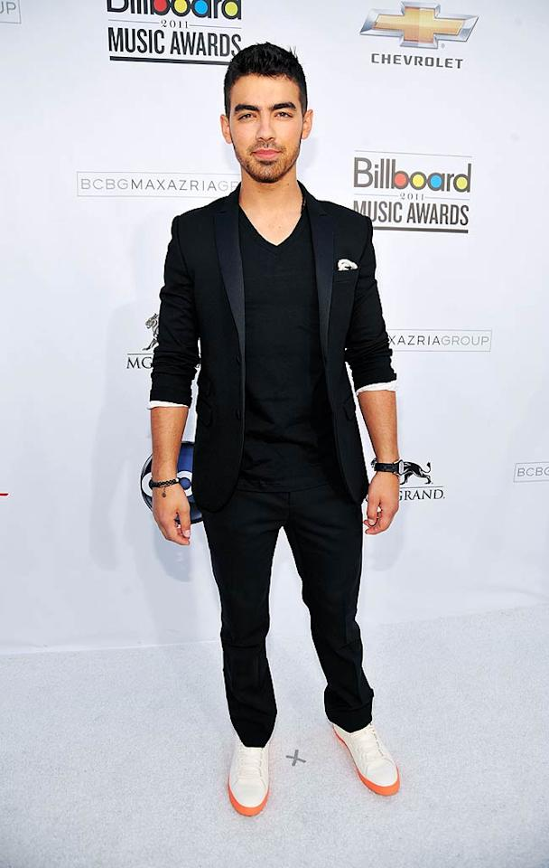 "Away from his bros for the night, pop star Joe Jonas sported a simple black suit. The 21-year-old spent the previous night hosting the Billboard Awards' official pre-party at Tao in The Venetian. Kevin Mazur/<a href=""http://www.wireimage.com"" target=""new"">WireImage.com</a> - May 22, 2011"