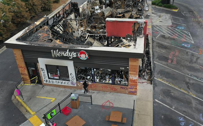 The Wendy's restaurant that was set on fire by demonstrators after Rayshard Brooks was killed is seen on June 17, 2020 in Atlanta, Georgia. / Credit: Joe Raedle/Getty Images