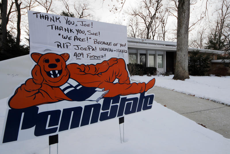 A sign of support is displayed in the front yard of Sue Paterno's home on the first anniversary of the death of her husband former Penn State head football coach Joe Paterno, Tuesday, Jan. 22, 2013 in State College, Pa. (AP Photo/Gene J. Puskar)