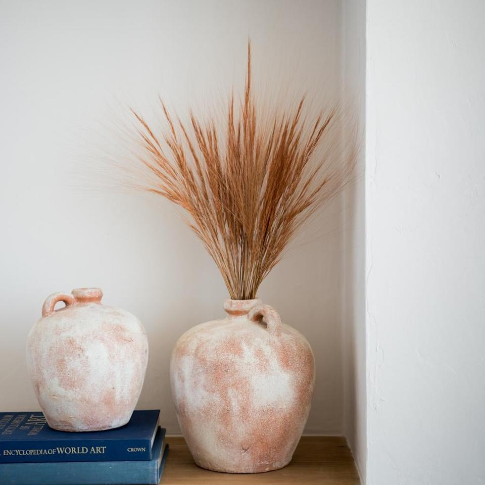 """<p>Inspired by ancient clay work, this <a href=""""https://www.popsugar.com/buy/Aged-Terracotta-Jug-488106?p_name=Aged%20Terracotta%20Jug&retailer=shop.magnolia.com&pid=488106&price=36&evar1=casa%3Aus&evar9=46582456&evar98=https%3A%2F%2Fwww.popsugar.com%2Fhome%2Fphoto-gallery%2F46582456%2Fimage%2F46582536%2FAged-Terracotta-Jug&list1=shopping%2Cdecor%20shopping%2C50%20under%20%2450%2Cjoanna%20gaines%2Chome%20shopping%2Cmagnolia%20home&prop13=api&pdata=1"""" rel=""""nofollow"""" data-shoppable-link=""""1"""" target=""""_blank"""" class=""""ga-track"""" data-ga-category=""""Related"""" data-ga-label=""""https://shop.magnolia.com/collections/vases/products/aged-terracotta-jug"""" data-ga-action=""""In-Line Links"""">Aged Terracotta Jug</a> ($36) flaunts a patina finish to create an aged look.</p>"""