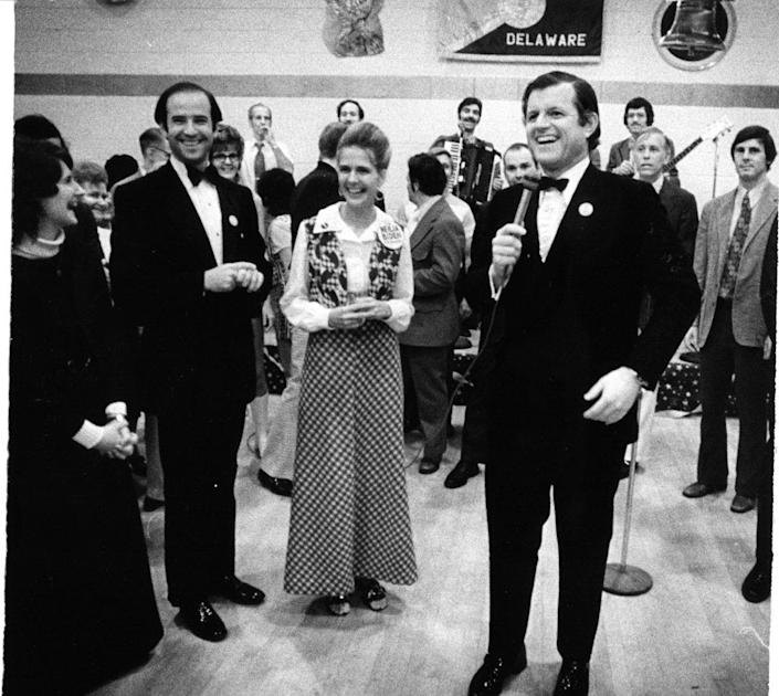 """U.S. Sen. Edward """"Ted """" Kennedy (front) appears at a Sept. 30, 1972, campaign event at Turners Hall in Wilmington to support local Democratic candidates, including Senate candidate Joe Biden (left), with his wife Neilia. Photo by Fred Comegys/ The News Journal"""