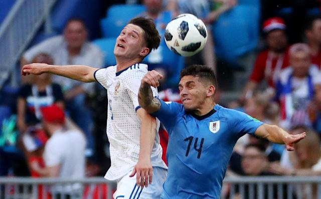 Soccer Football - World Cup - Group A - Uruguay vs Russia - Samara Arena, Samara, Russia - June 25, 2018 Russia's Aleksei Miranchuk in action with Uruguay's Lucas Torreira REUTERS/Pilar Olivares