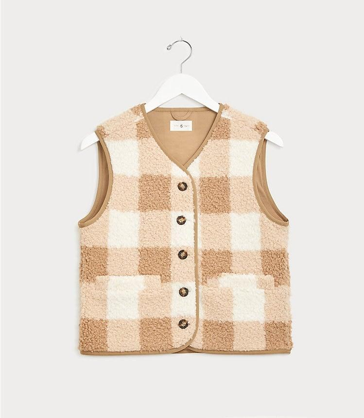 <p>Layer this <span>Lou & Grey Buffalo Plaid Cozy Up Vest</span> ($90) with a comfy turtleneck.</p>