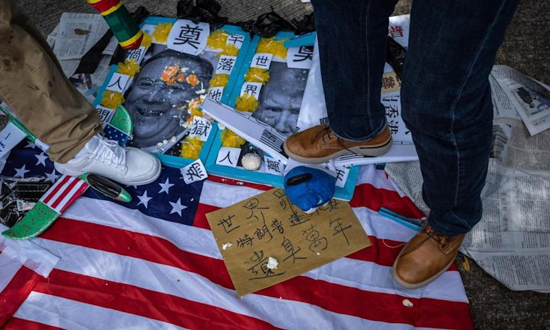 Pro-China activists step on photographs of US President Donald J. Trump and US Secretary of State Mike Pompeo, outside the US Consulate in Hong Kong