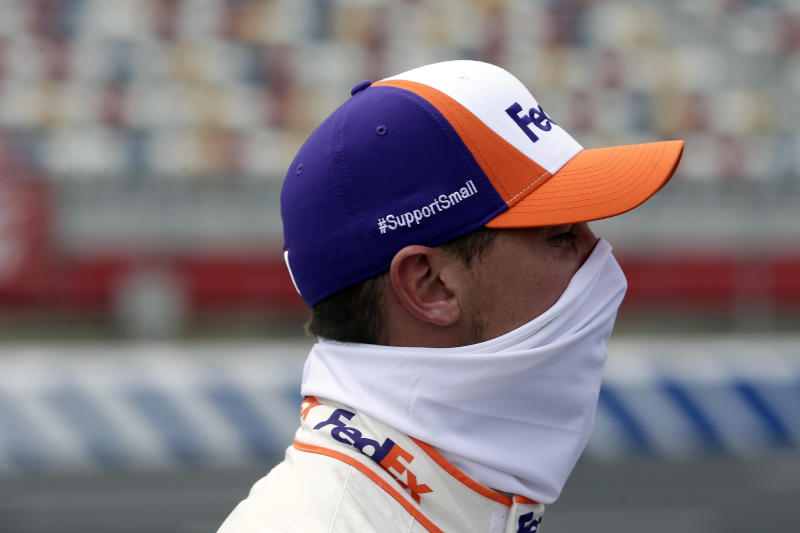 Driver Denny Hamlin waits during qualifying prior to a NASCAR Cup Series auto race at Charlotte Motor Speedway Sunday, May 24, 2020, in Concord, N.C. (AP Photo/Gerry Broome)