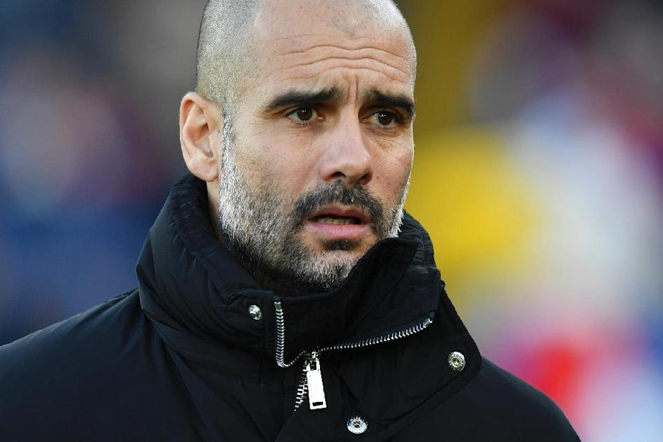 """Manchester City manager Pep Guardiola defended Claudio Bravo, calling him a """"top, top goalkeeper"""", but refused to say if he will restore the Chilean to his starting XI (AFP Photo/Ben STANSALL)"""