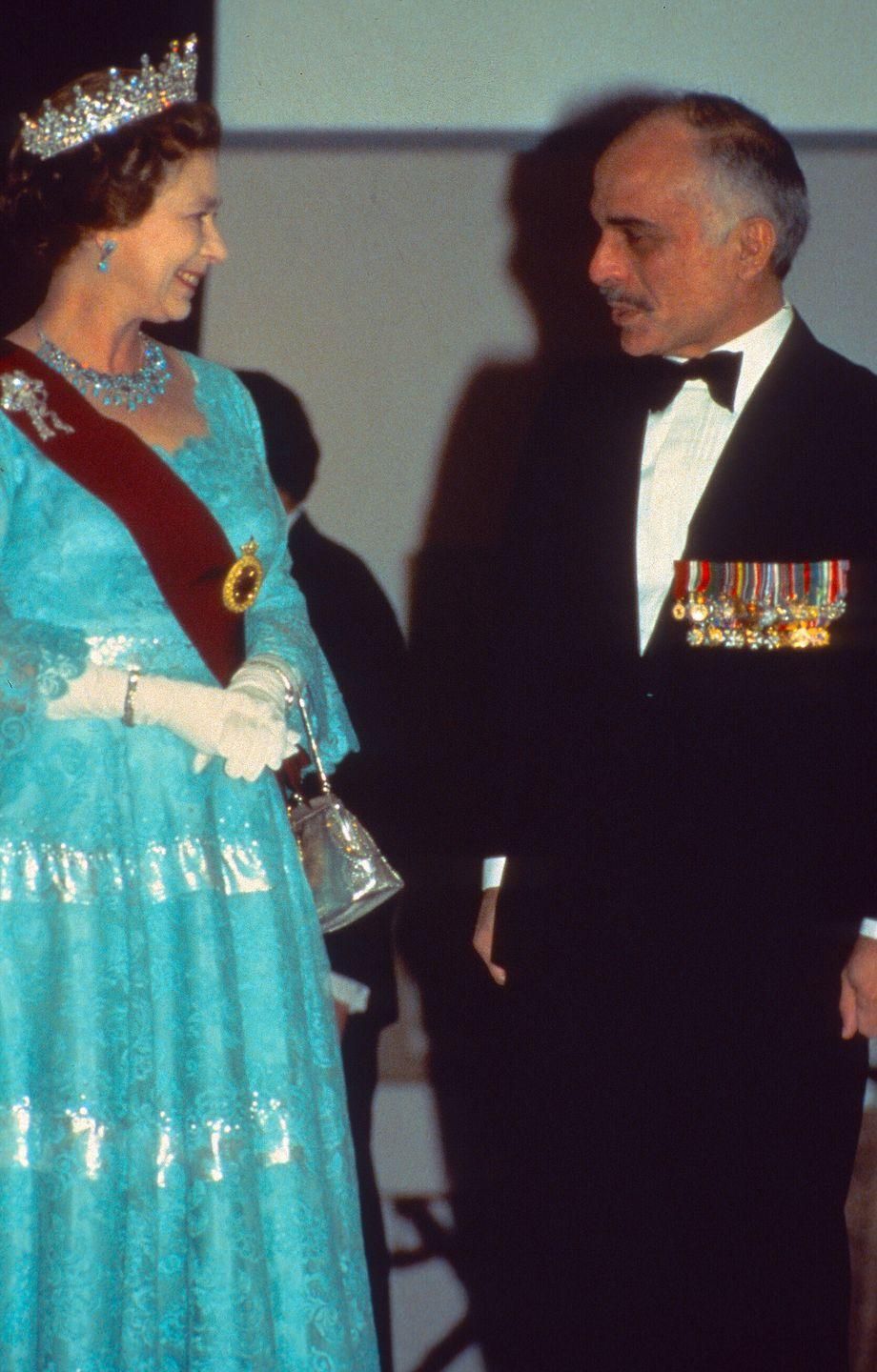 <p>King Hussein of Jordan gifted Queen Elizabeth a suite of turquoise and sapphire jewelry (a necklace and earrings) during his official trip to England in 1966. When she paid a return visit in 1984, the monarch wore the set to a state banquet. </p>