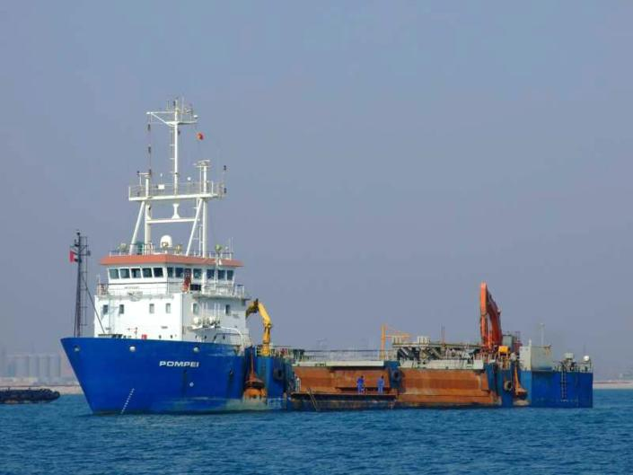 In this undated handout photo provided by the Belgian government, the Belgian ship Pompei, owned by De Nul, is shown in unidentified waters. One of Somalia's most notorious pirate leaders, Mohamed Abdi Hassan, was arrested in Brussels on Saturday, Oct. 12, 2013 and placed in custody pending charges, judicial sources said Monday. Hassan is suspected of the 2009 capture of the Belgian ship, the Pompei, which was held for over 70 days. (AP Photo/ Belgian Government)