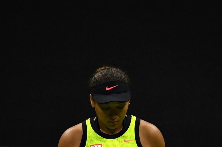Naomi Osaka withdrew from the French Open and skipped Wimbledon this year over mental health issues she said were exacerbated by the harsh light of media attention (AFP/Ed JONES)