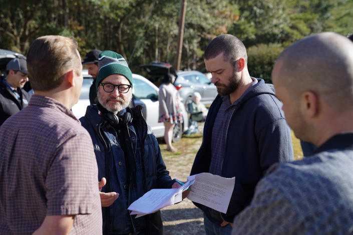 """This image released by Apple shows director Fisher Stevens, second left, and Justin Timberlake on the set of """"Palmer."""" (Apple via AP)"""