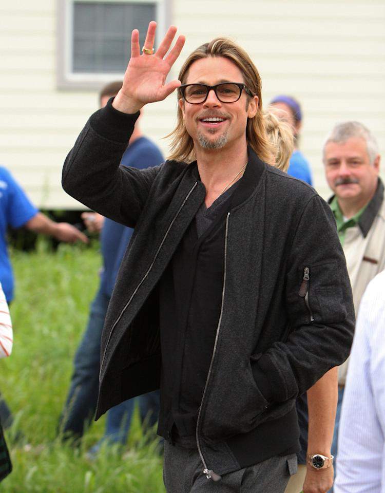Brad Pitt made several stops in the Lower Ninth Ward visiting residents who live in the Make It Right Houses. He also filmed with Ellen DeGeneres for her show. She is in town helping to raise money for the Make It Right Foundation. Brad took time to pose for photos with volunteers who are helping to construct the homes. 