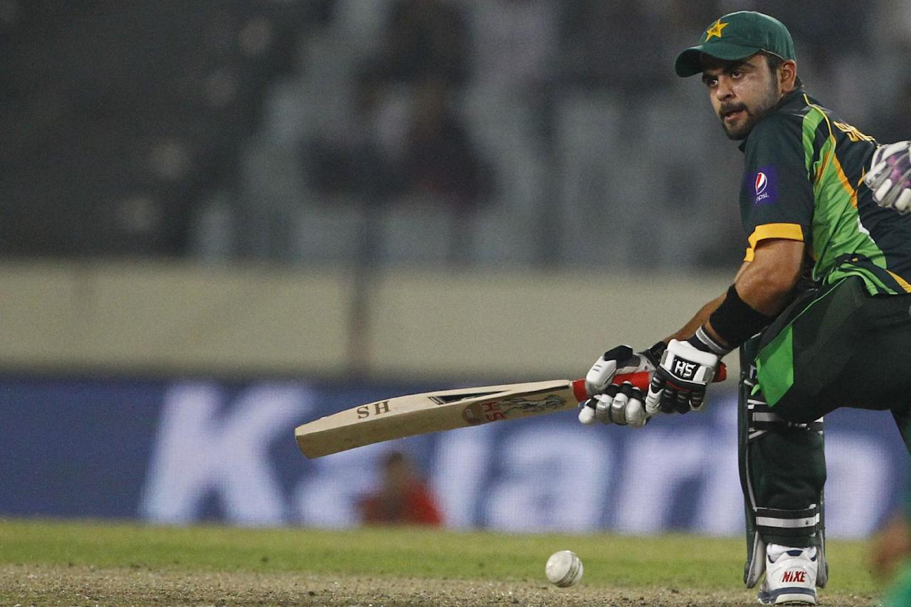 Pakistan's Ahmed Shehzad plays a shot during their match against Bangladesh in the Asia Cup one-day international cricket tournament in Dhaka, Bangladesh, Tuesday, March 4, 2014. (AP Photo/A.M. Ahad)
