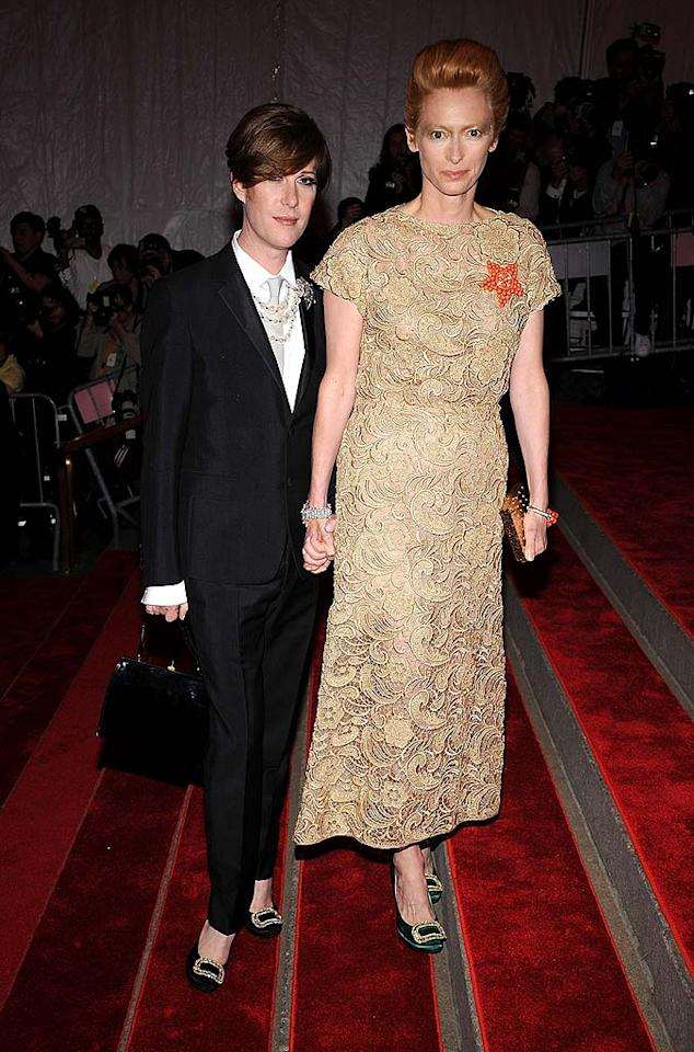 "Oscar winner Tilda Swinton opted for dramatic hair and makeup, however her dowdy beige dress and tuxedoed arm candy left us puzzled. Dimitrios Kambouris/<a href=""http://www.wireimage.com"" target=""new"">WireImage.com</a> - May 5, 2008"