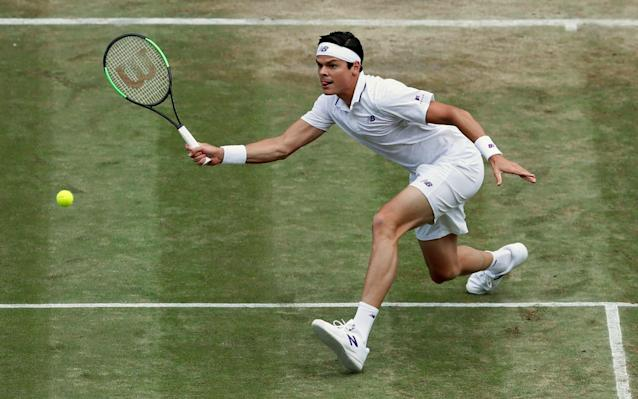 <span>Milos Raonic hits a volley during clash with Federer</span>