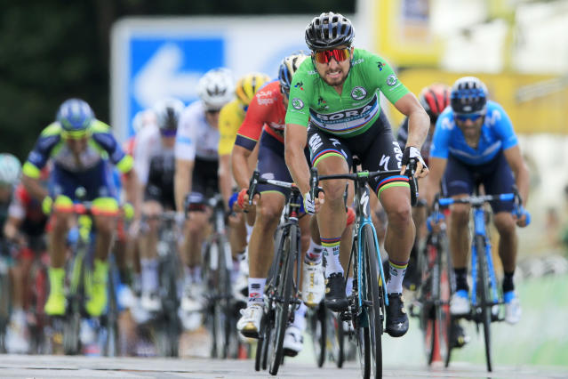 Slovakia's Peter Sagan, wearing the best sprinter's green jersey, crosses the finish line to win the fifth stage of the Tour de France cycling race over 204.5 kilometers (127 miles) with start in Lorient and finish in Quimper, France, Wednesday, July 11, 2018. (AP Photo/Peter Dejong)