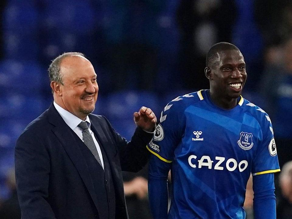 Rafa Benitez and Abdoulaye Doucoure celebrate after Monday's win over Burnley at Goodison Park (PA)
