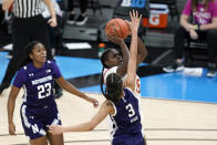 Maryland's Ashley Owusu (15) shoots over Northwestern's Sydney Wood (3) during the second half of an NCAA college basketball semifinal game at the Big Ten Conference tournament, Friday, March 12, 2021, in Indianapolis. (AP Photo/Darron Cummings)
