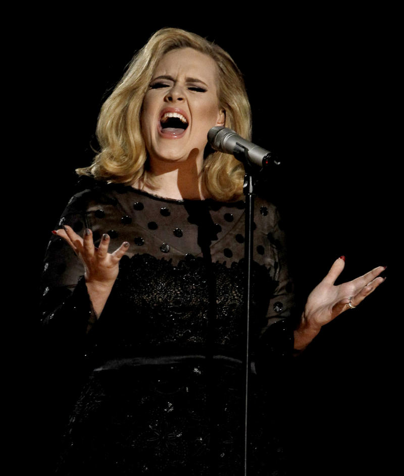 """FILE - This Feb. 12, 2012 file photo shows Adele performing during the 54th annual Grammy Awards in Los Angeles. Adele has the year's top-selling album on iTunes. Her """"21,"""" which recently passed the 10 million mark in sales, topped the list even though it was first released at the top of 2011. It remained popular this year, particularly after she nabbed five Grammys in February.   (AP Photo/Matt Sayles, file)"""