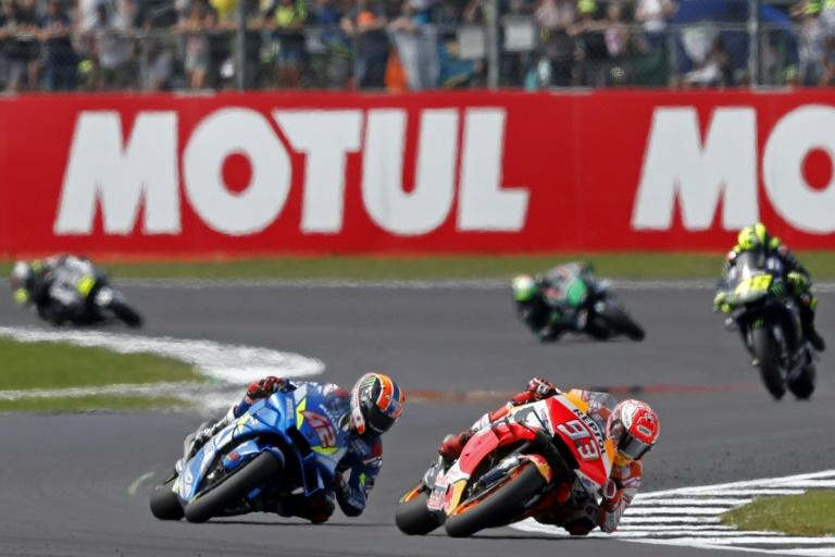 Alex Rins trailed Marc Marquez entering the final corner at Silverstone