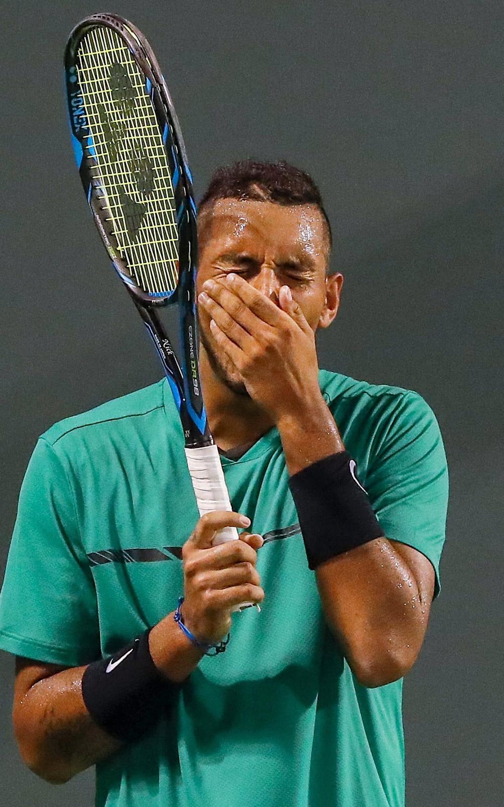 Nick Kyrgios reacts during his defeat to Roger Federer - Credit: EPA