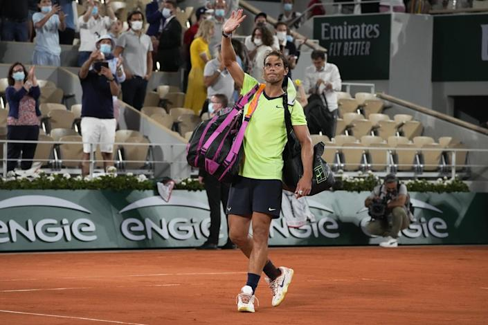 Rafael Nadal waves after losing to Novak Djokovic in their semifinal match of the French Open on June 11.