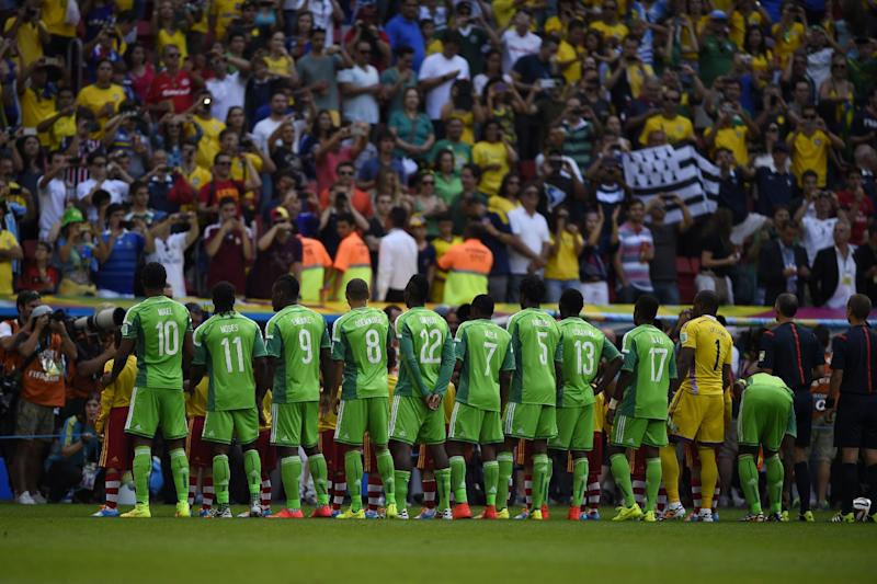 Nigeria players stand on the pitch prior to the match against France at Mane Garrincha National Stadium in Brasilia during the 2014 FIFA World Cup on June 30, 2014 (AFP Photo/Fabrice Coffrini)