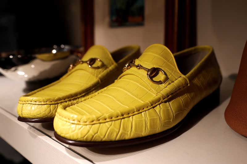 FILE PHOTO: Gucci alligator skin shoes for sale are displayed at The RealReal shop in New York City
