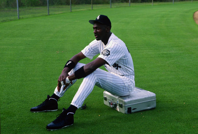 Michael Jordan sits on a camera case before a photo shoot at Hoover Metropolitan Stadium in Birmingham, Alabama. (Photo by Focus on Sport/Getty Images)