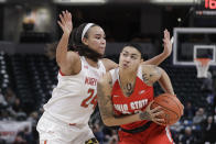 Ohio State's Kierstan Bell (24) goes to the basket against Maryland's Stephanie Jones (24) during the second half of an NCAA college basketball championship game at the Big Ten Conference tournament, Sunday, March 8, 2020, in Indianapolis. Maryland defeated Ohio State 82-65. (AP Photo/Darron Cummings)