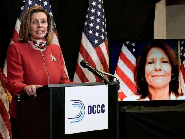 PHOTO: Speaker of the House Nancy Pelosi talks to reporters along with Rep. Cheri Bustos, who appears on screen, Nov. 3, 2020, at the Democratic National Committee headquarters in Washington, D.C. (Pool via AFP/Getty Images, FILE)