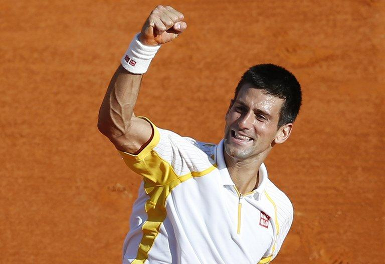 Serbia's Novak Djokovic celebrates winning the Monte-Carlo ATP Masters Series on April 21, 2013 in Monaco. Djokovic, Rafael Nadal and Roger Federer appear at the same claycourt event for the first time this season with the Madrid Masters a key test just three weeks out from the French Open