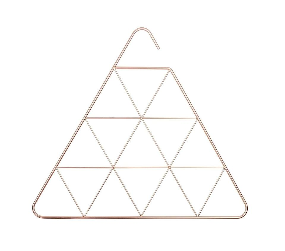 "<p>If you're not willing to compromise aesthetics, consider buying the <a href=""https://www.popsugar.com/buy/Umbra-Pendant-Diamond-Geometric-Copper-Scarf-HangerAccessory-Hanger-580618?p_name=Umbra%20Pendant%20Diamond%20Geometric%20Copper%20Scarf%20Hanger%2FAccessory%20Hanger&retailer=amazon.com&pid=580618&price=36&evar1=casa%3Aus&evar9=45752594&evar98=https%3A%2F%2Fwww.popsugar.com%2Fhome%2Fphoto-gallery%2F45752594%2Fimage%2F45753882%2FScarfs-Belts&list1=amazon%2Caccessories%2Corganization%2Cstorage%20tips%2Chome%20organization&prop13=mobile&pdata=1"" class=""link rapid-noclick-resp"" rel=""nofollow noopener"" target=""_blank"" data-ylk=""slk:Umbra Pendant Diamond Geometric Copper Scarf Hanger/Accessory Hanger"">Umbra Pendant Diamond Geometric Copper Scarf Hanger/Accessory Hanger</a> ($36). The geometric copper design is as trendy as it is functional. </p>"