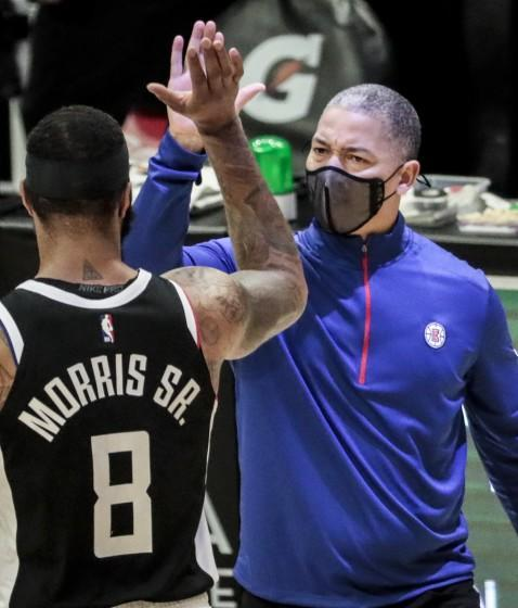 Clippers head coach Tyronn Lue high-fives forward Marcus Morris during a break in the action against the Pacers.