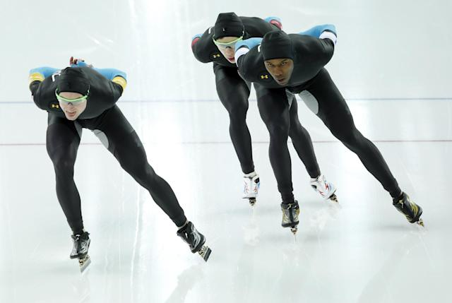 The U.S. speedskating team Shani Davis, right, Brian Hansen, center, and Jonathan Kuck, left, compete in the men's speedskating team pursuit quarterfinals at the Adler Arena Skating Center during the 2014 Winter Olympics in Sochi, Russia, Friday, Feb. 21, 2014. (AP Photo/Patrick Semansky)