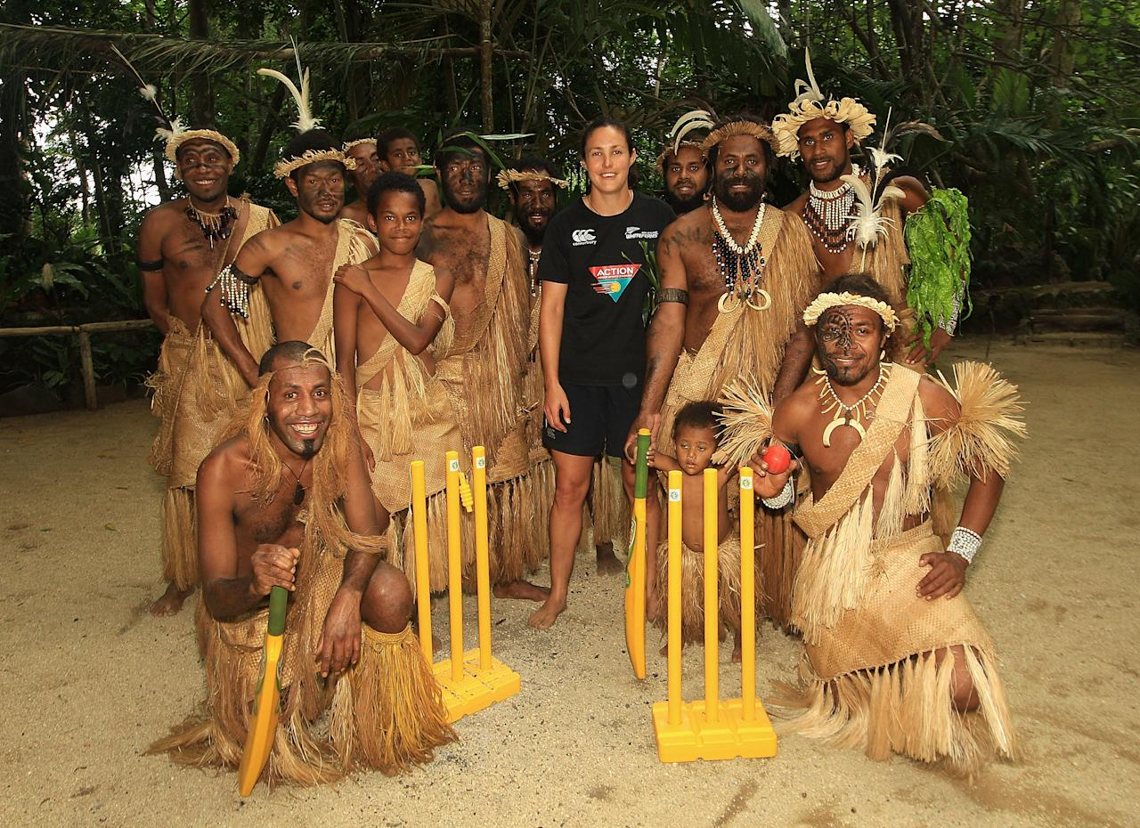PORT VILA, VANUATU - MAY 16:  New Zealand cricketer Sara McGlashan with locals in traditional dress during an ICC Cricket Development Program Clinic at Ekasup Cultural Village on May 16, 2012 in Port Vila, Vanuatu.  (Photo by Hamish Blair/Getty Images)