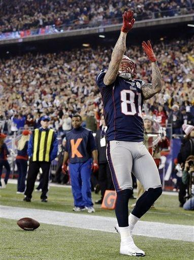 New England Patriots tight end Aaron Hernandez (81) celebrates his touchdown catch against the Houston Texans during the second quarter of an NFL football game in Foxborough, Mass., Monday, Dec. 10, 2012. (AP Photo/Elise Amendola)