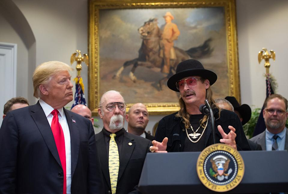 US President Donald Trump watches on as musician Kid Rock (R) speaks after signing the Hatch-Goodlatte Music Modernization A in the Roosevelt Room of the White House in Washington, DC, October 11, 2018.