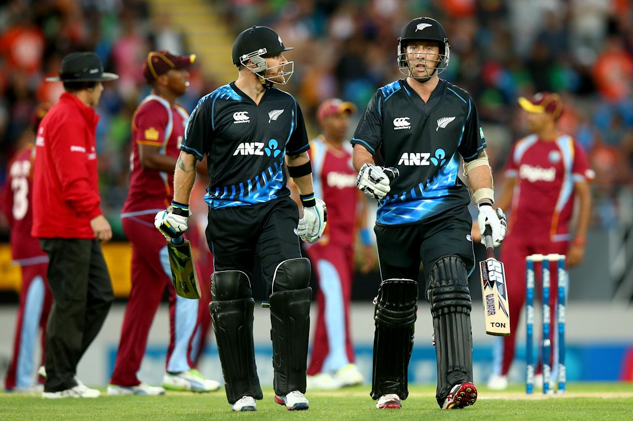 AUCKLAND, NEW ZEALAND - JANUARY 11:  Brendon McCullum (L) and Luke Ronchi (R) of New Zealand leave the field at the end of their innings during the first T20 between New Zealand and the West Indies at Eden Park on January 11, 2014 in Auckland, New Zealand.  (Photo by Phil Walter/Getty Images)