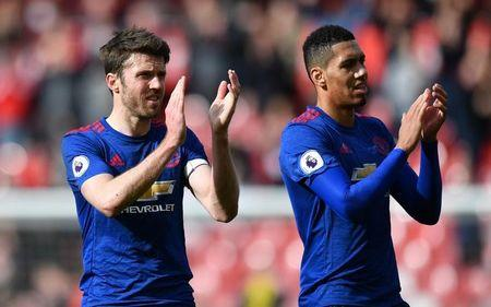 Britain Soccer Football - Middlesbrough v Manchester United - Premier League - The Riverside Stadium - 19/3/17 Manchester United's Michael Carrick and Chris Smalling applaud fans after the game  Reuters / Anthony Devlin Livepic
