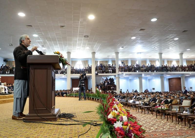Afghanistan's presidential candidate Abdullah Abdullah speaks during a gathering with his supporters in Kabul, Afghanistan