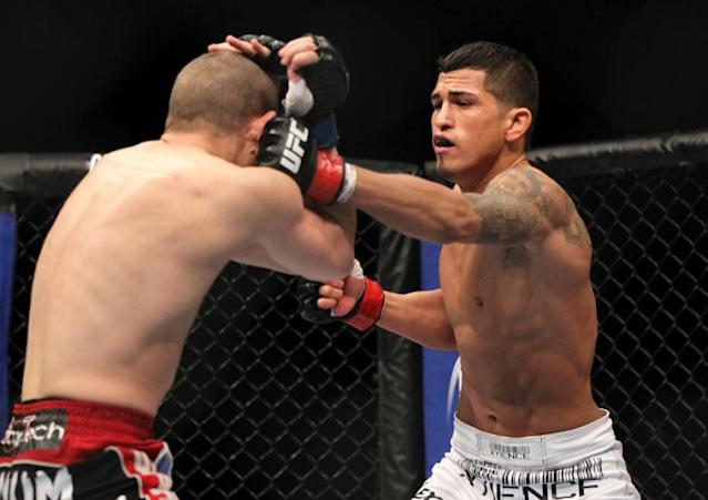 SAITAMA, JAPAN - FEBRUARY 26: (R-L) Anthony Pettis punches Joe Lauzon during the UFC 144 event at Saitama Super Arena on February 26, 2012 in Saitama, Japan.